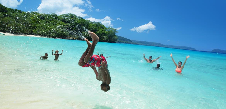 Kids on a beach in Vanuatu