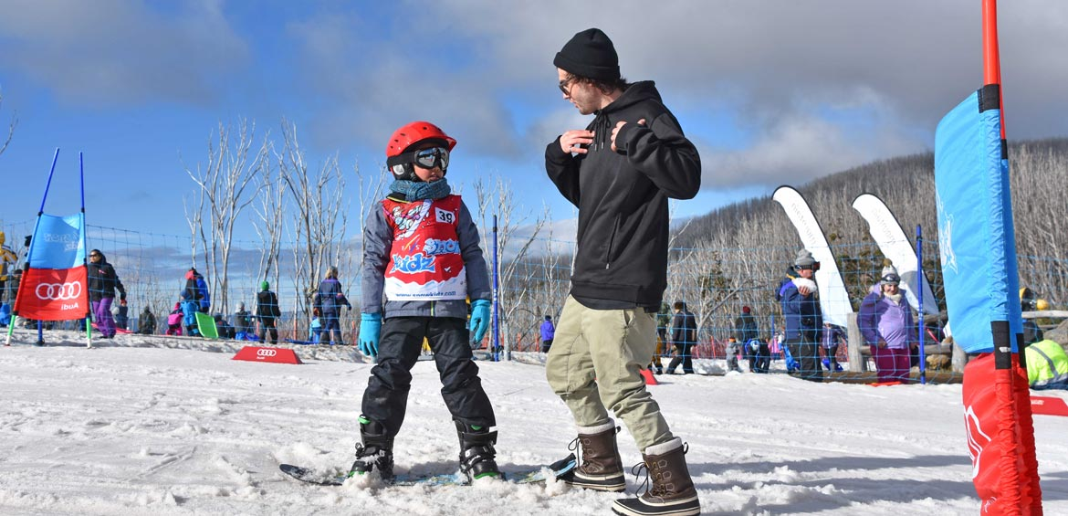 Learning how to snowboard at Lake Mountain Alpine Resort