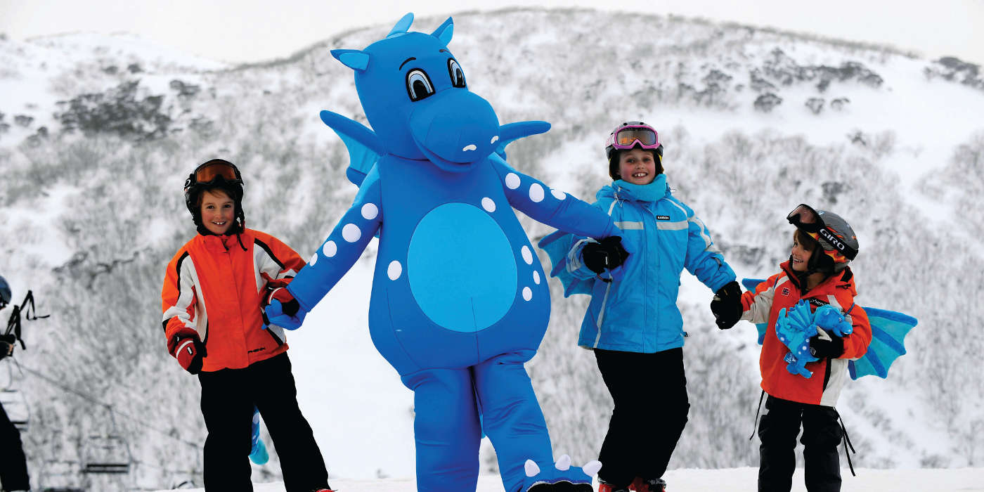 Harry the Dragon with some children. Mt Hotham