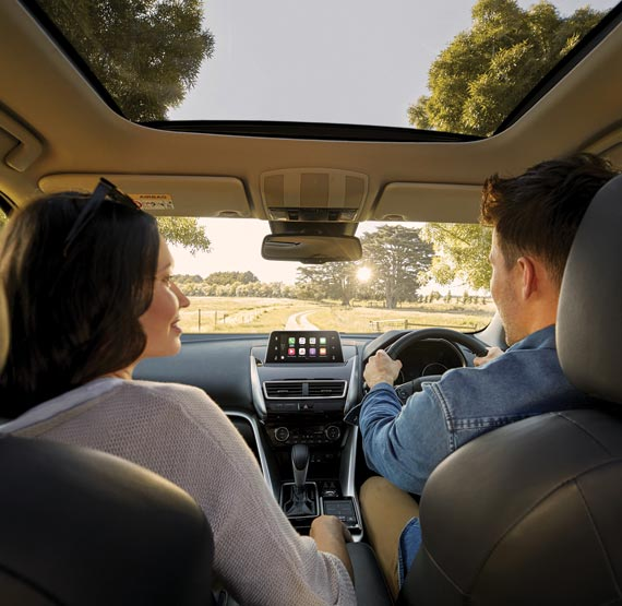 Mum and dad in the Mitsubishi Eclipse Cross LS SUV