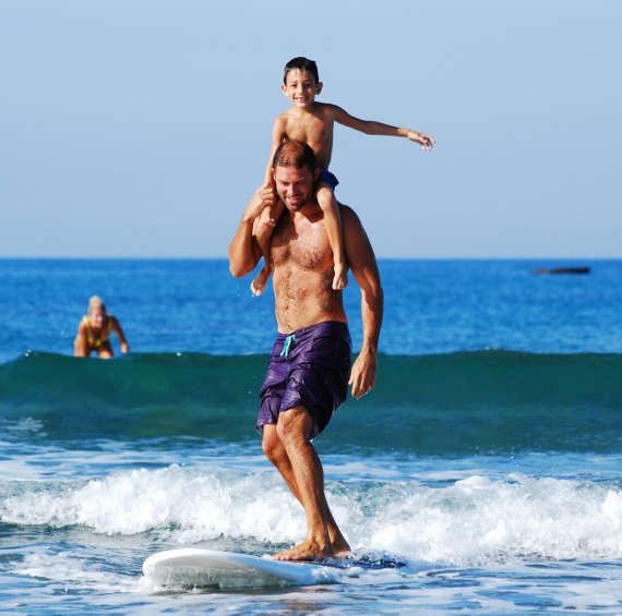 dad kid surfing family