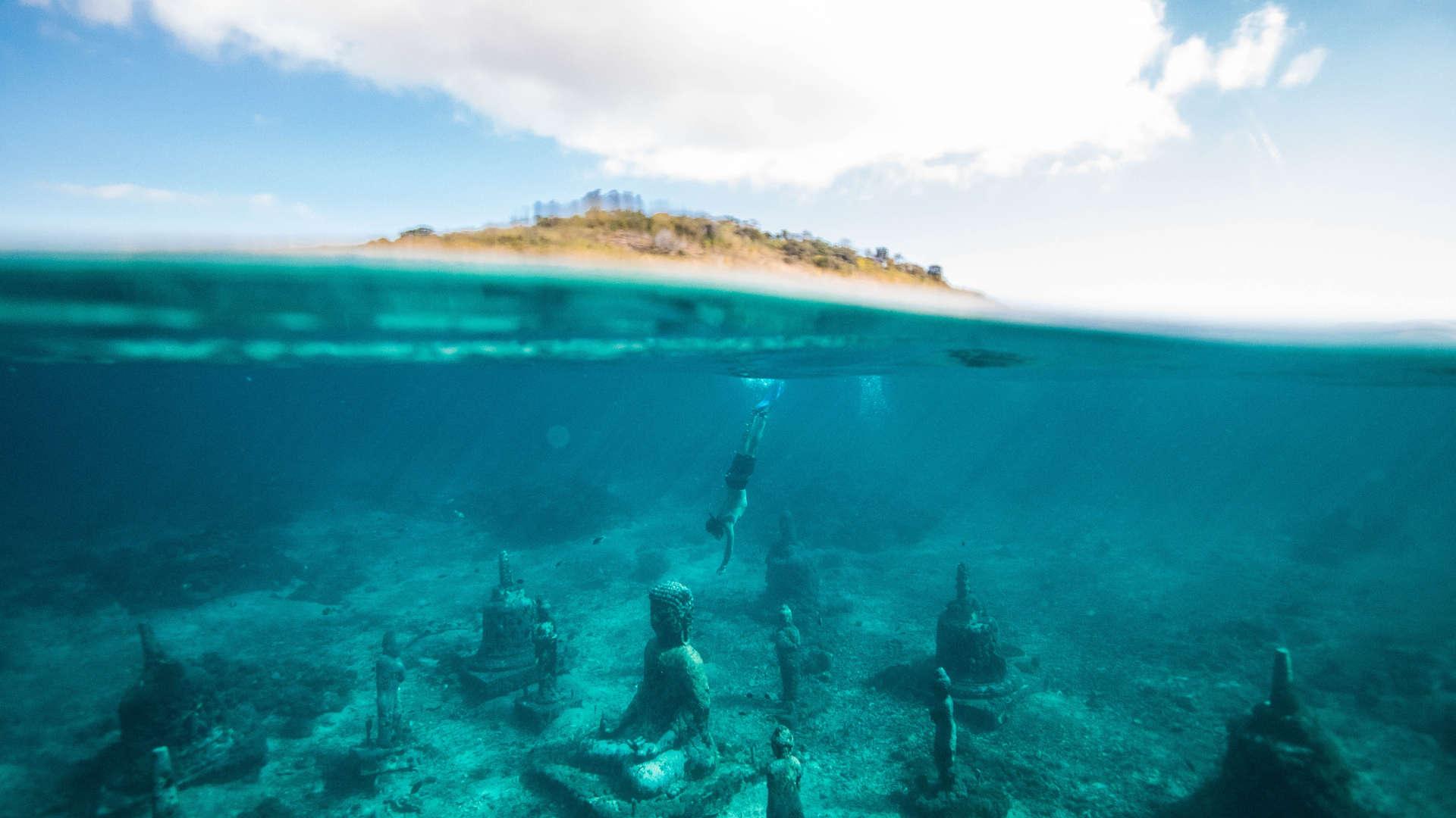 indonesia bali diving buddhism submerged buddhas