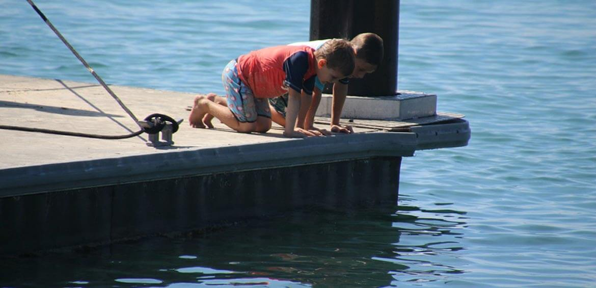 Boys on the pier in the Bribie Island