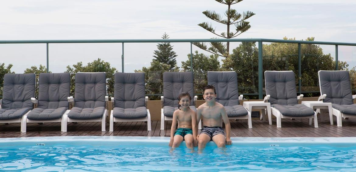 Kids at the pool at Crowne Plaza Coogee Beach Hotel