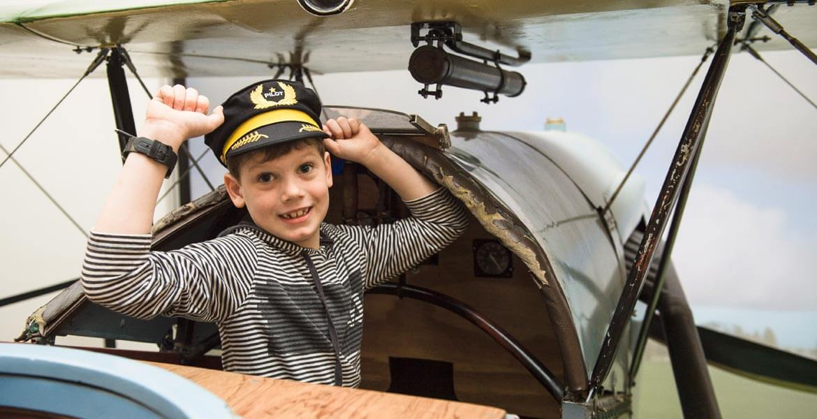 Kid in a plane at Qantas Founders Museum