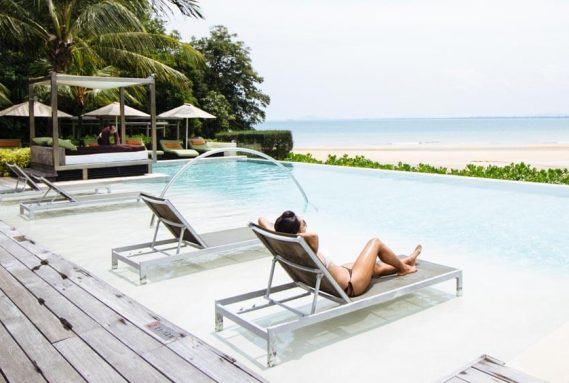 Relaxing by the pool at Club Med Cherating Beach