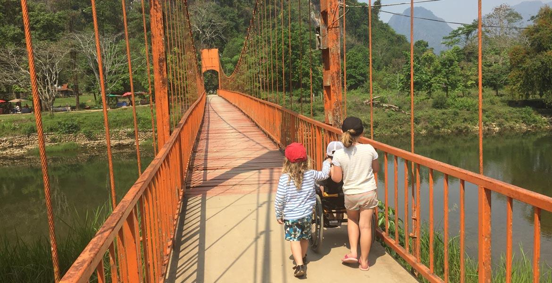Walking over a bridge in Laos