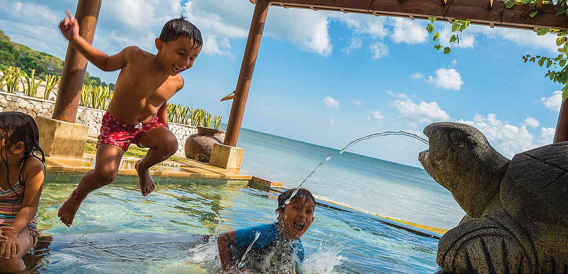 Splashing at Jimba Kids' Club, Four Seasons Resort Bali at Jimbaran Bay kids' club