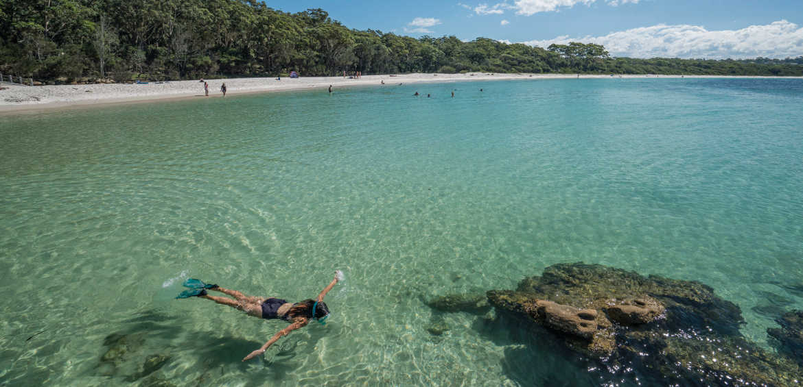 Woman snorkelling in the clear waters of Greenpatch, Jervis Bay. © Dee Kramer