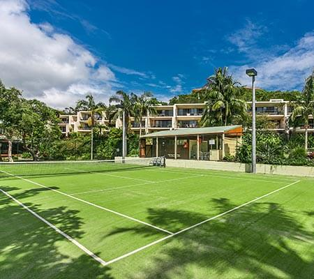 Tennis court at Oasis Apartments & Treetop Houses