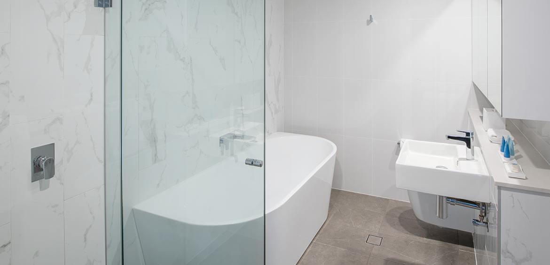 Bathroom at Meriton Suites Carter Street