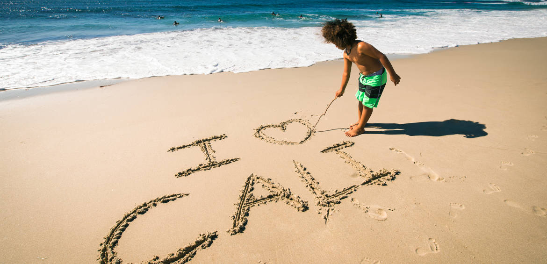 beach_boy_writing_Copyright Myles McGuinness