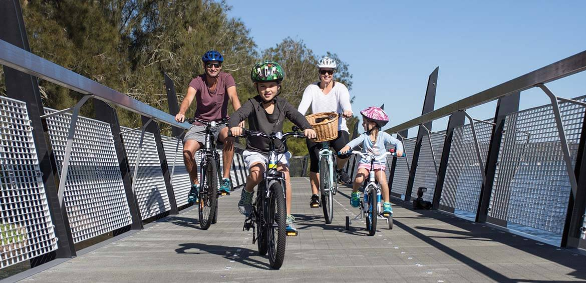 A family cycling in Lake Macquariue