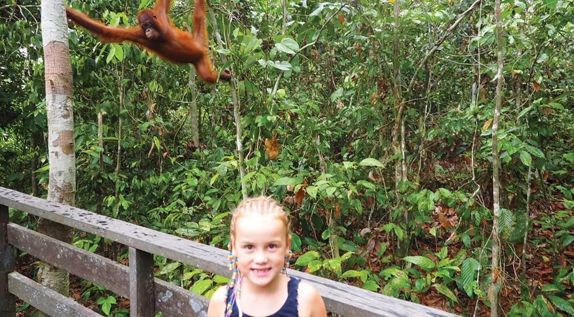 Emmie meets an orangutan in Sabah