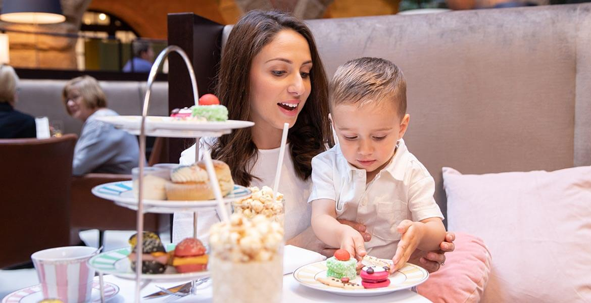 Mother and son enjoing InterContinental Sydney's high tea