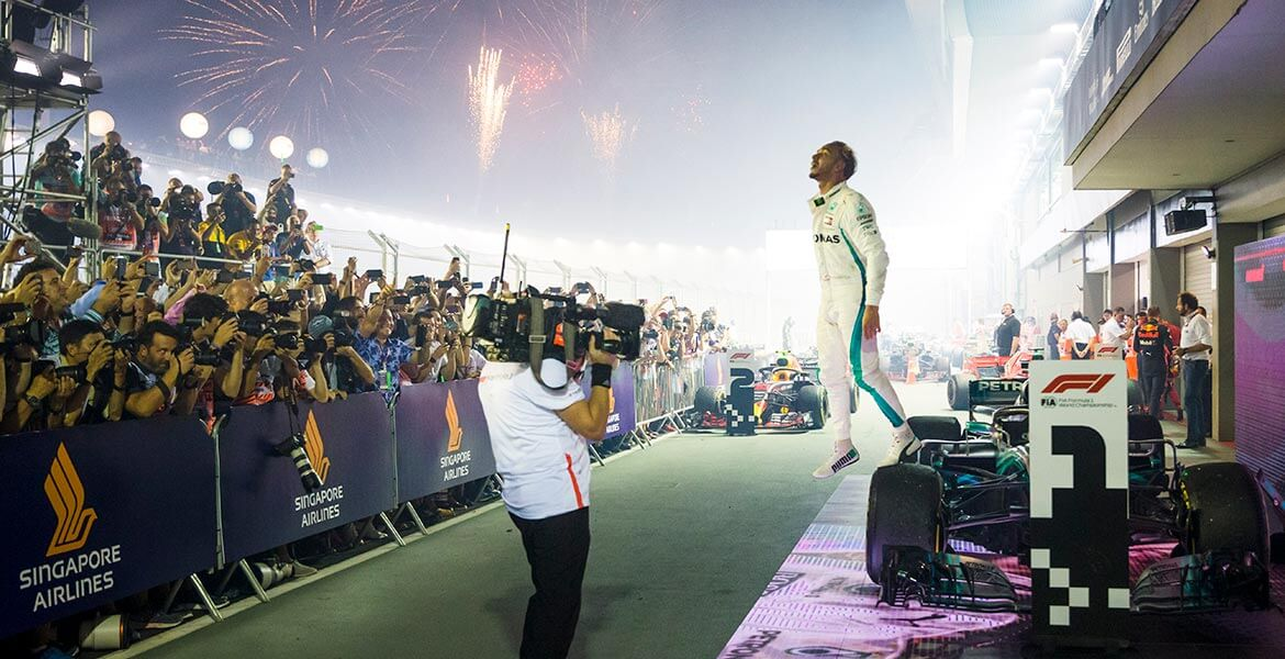 A victorious Lewis Hamilton celebrates in parc ferme after winning the Formula 1 2018 Singapore Grand Prix