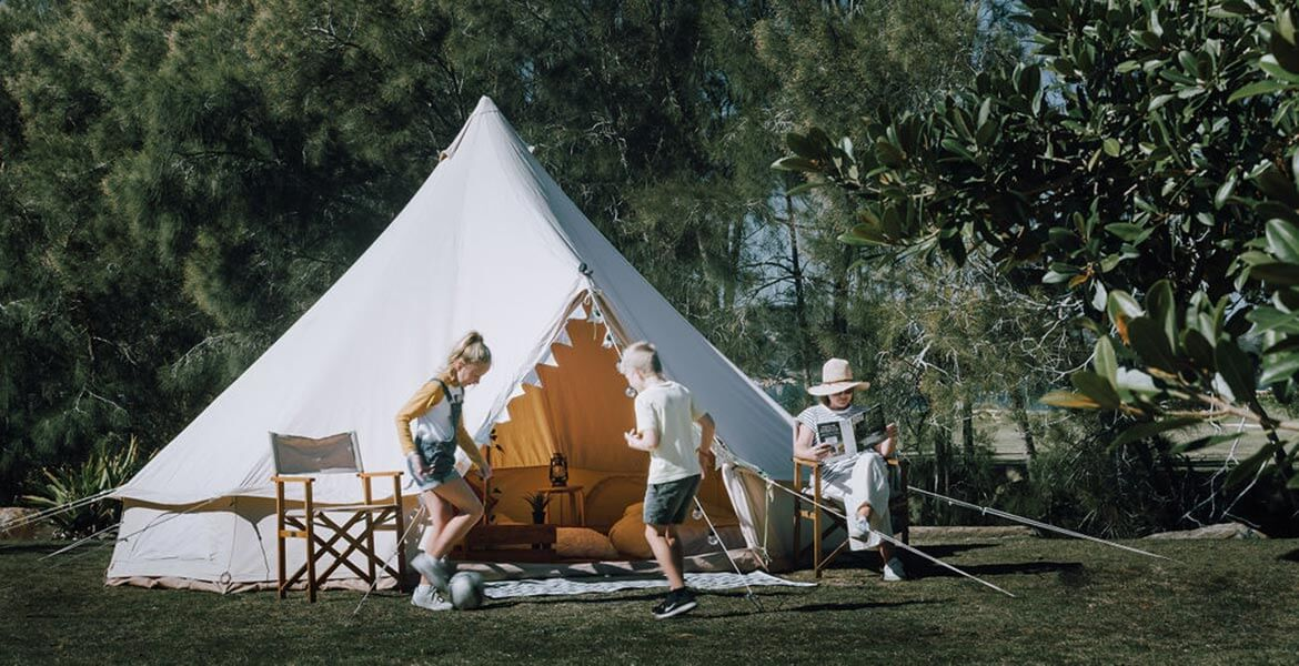 Family fun in the Glamping Bell Tents, NRMA Ocean Beach Holiday Resort