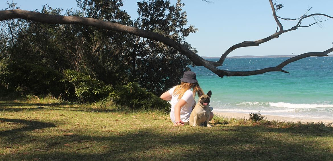Daughter and dog sitting at Holiday Haven Huskinsson Beach