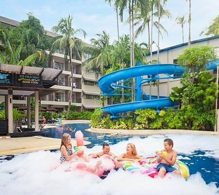 Family in the pool at Novotel Phuket Surin Beach Resort