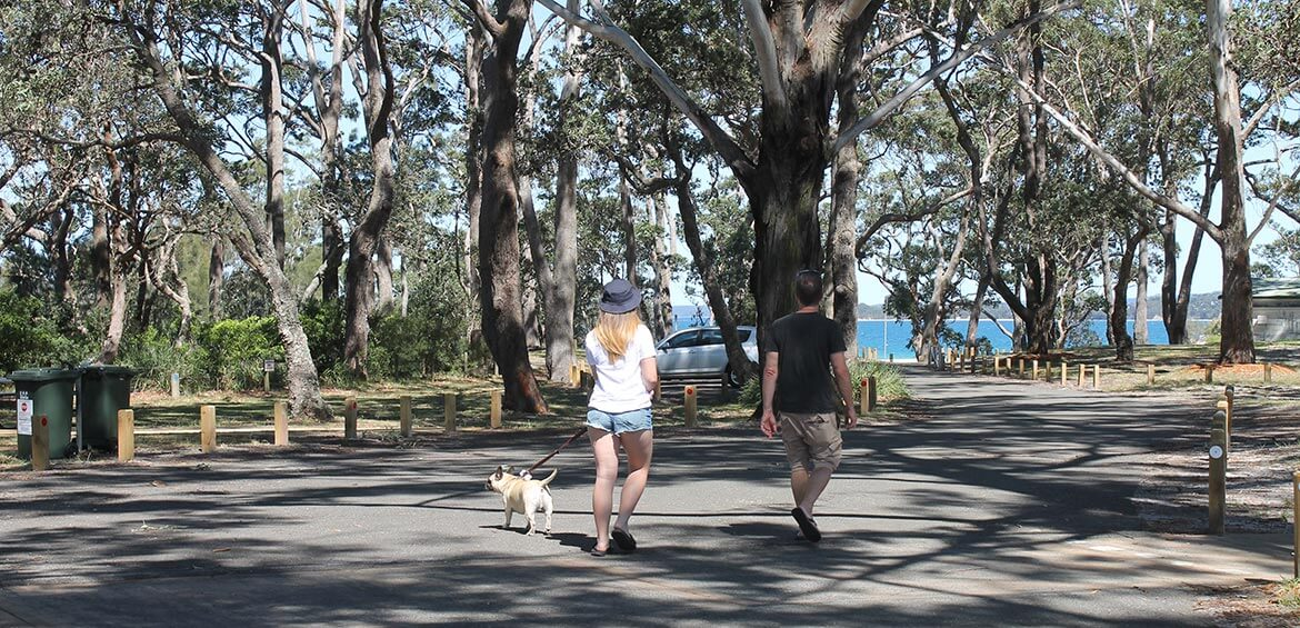 Father and daughter walking to the beach at Holiday Haven Huskisson Beach