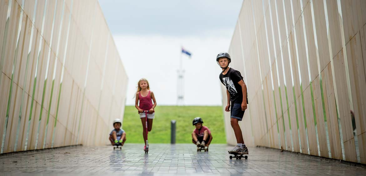 Kids scooting around Commonwealth Place