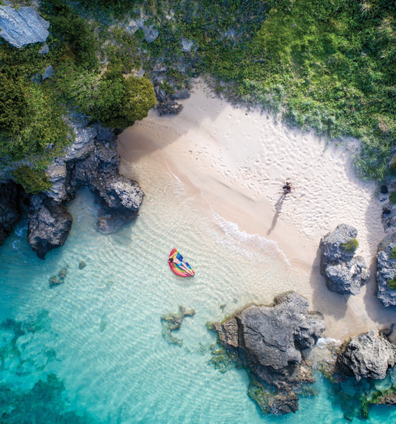 Aerial beach with lilo and person