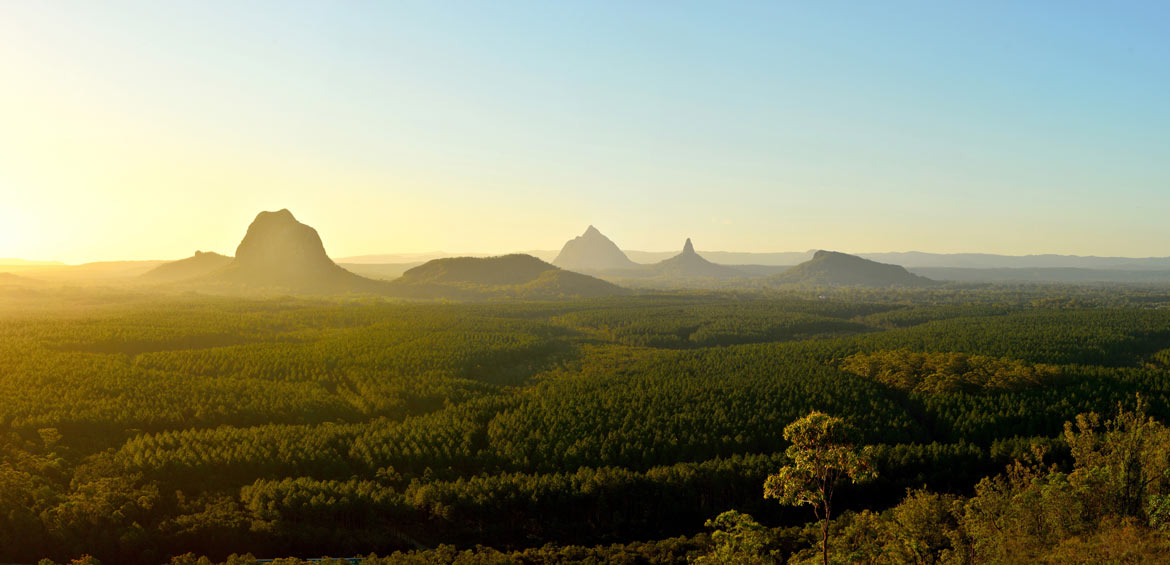 Panoramic view of Glass House Mountains (including Tibrogargan, Cooee, Beerwah, Coonowrin and Ngungun) at sunset in Queensland, Australia.