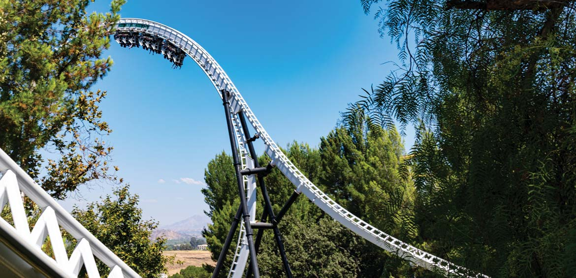 Six Flags Magic Mountain. people seeking thrill riding a roller coaster