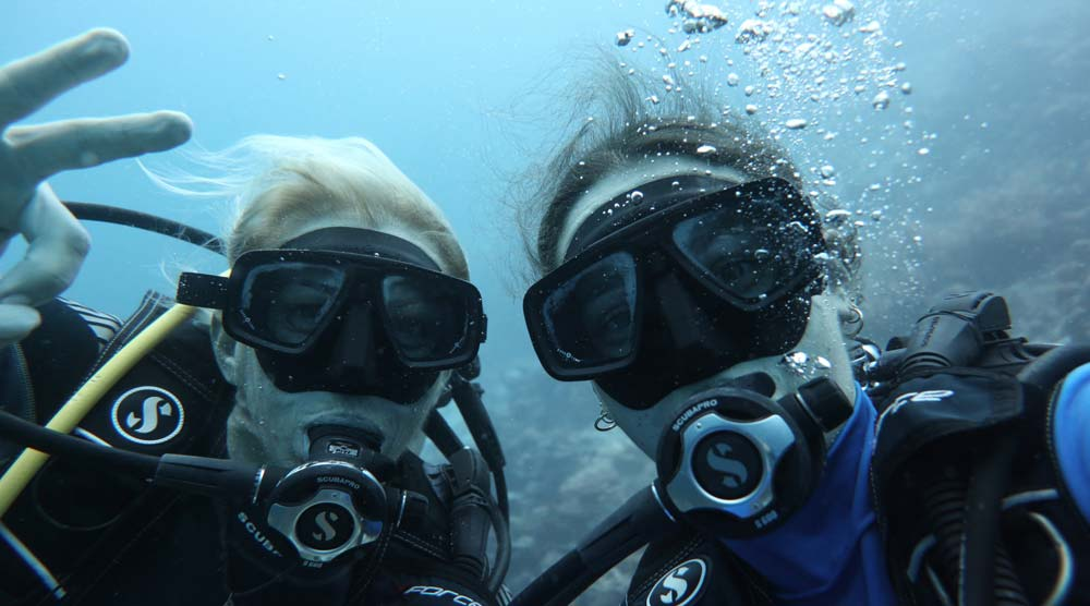 Mother daughter diving in the Maldives