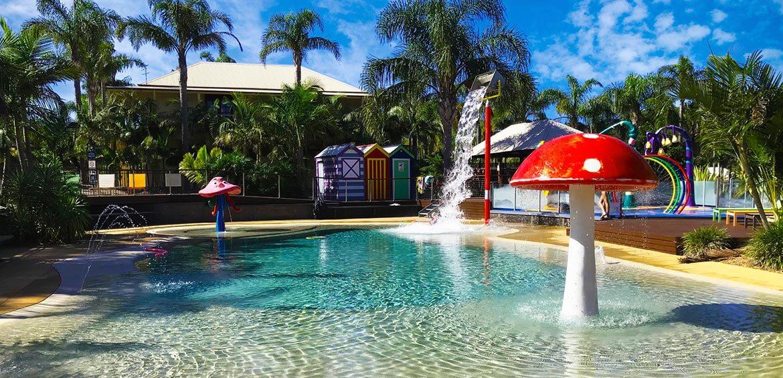 Pool with splashpad at Wairo Beach Holiday Park