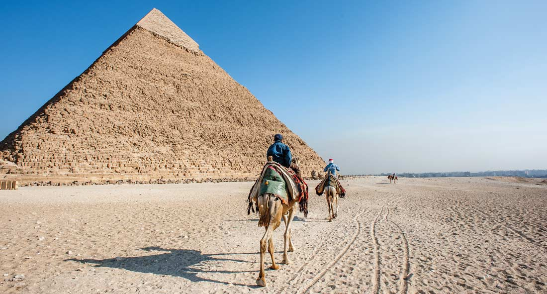 Camel caravan at the Pyramids of Giza, Egypt