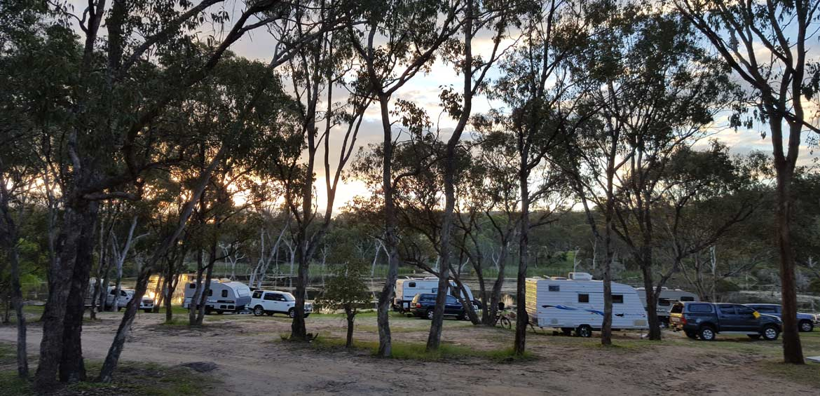 Camp by the river at Country Style Caravan Park