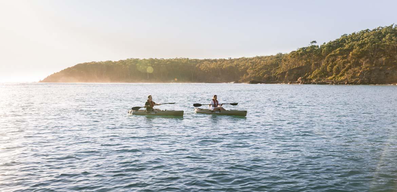 Couple enjoying a paddle on Pambula River, Pambula