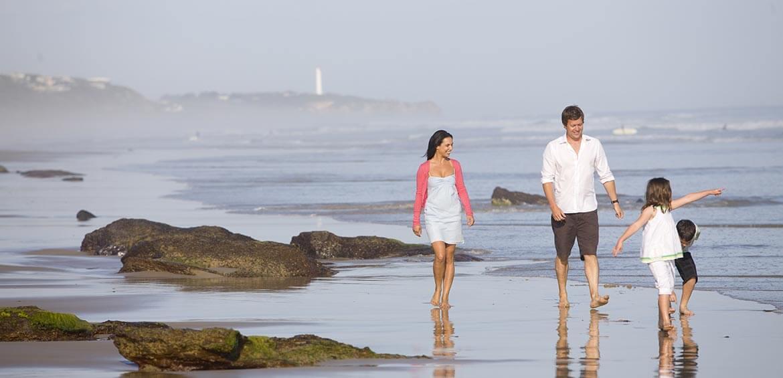 Family walking on Fairhaven Beach, Otway