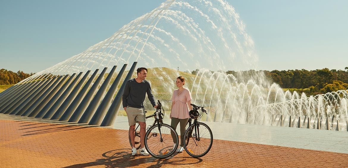 Parents cycling at Sydney Olympic Park