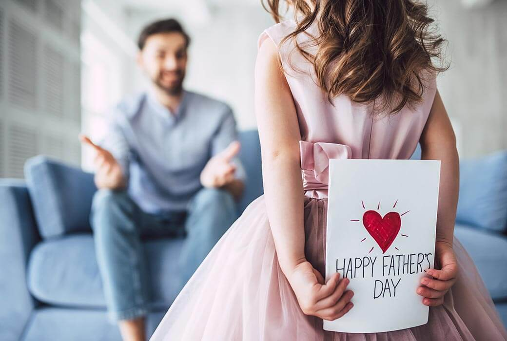 Daughter giving dad a Father's Day card