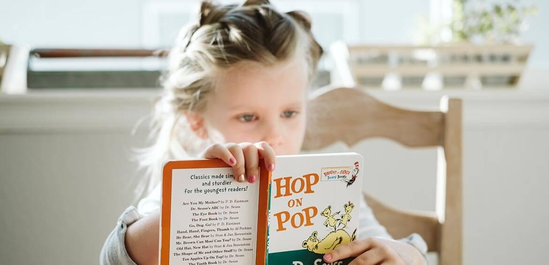 Girl reading Hop on Pop