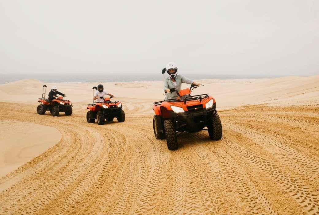 Shor breaks from Sydney: Quad biking at Stockton Sand Dunes © Destination NSW