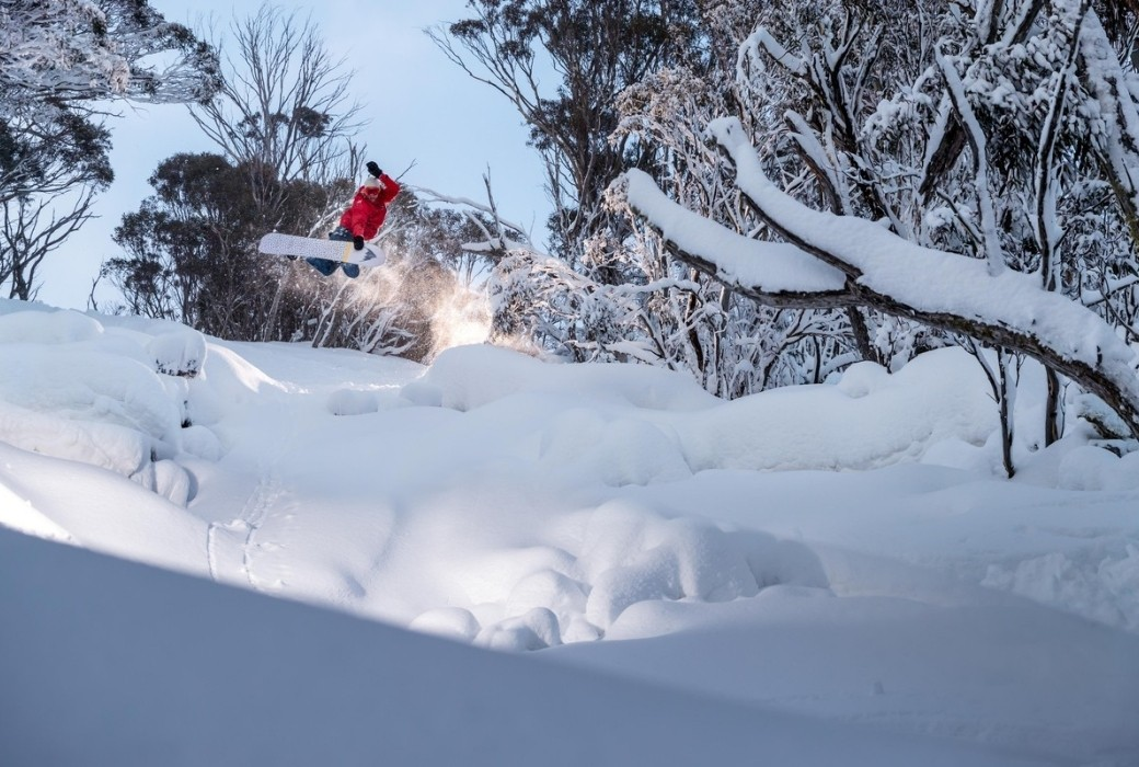 A snowboarder doing a Method at Thredo