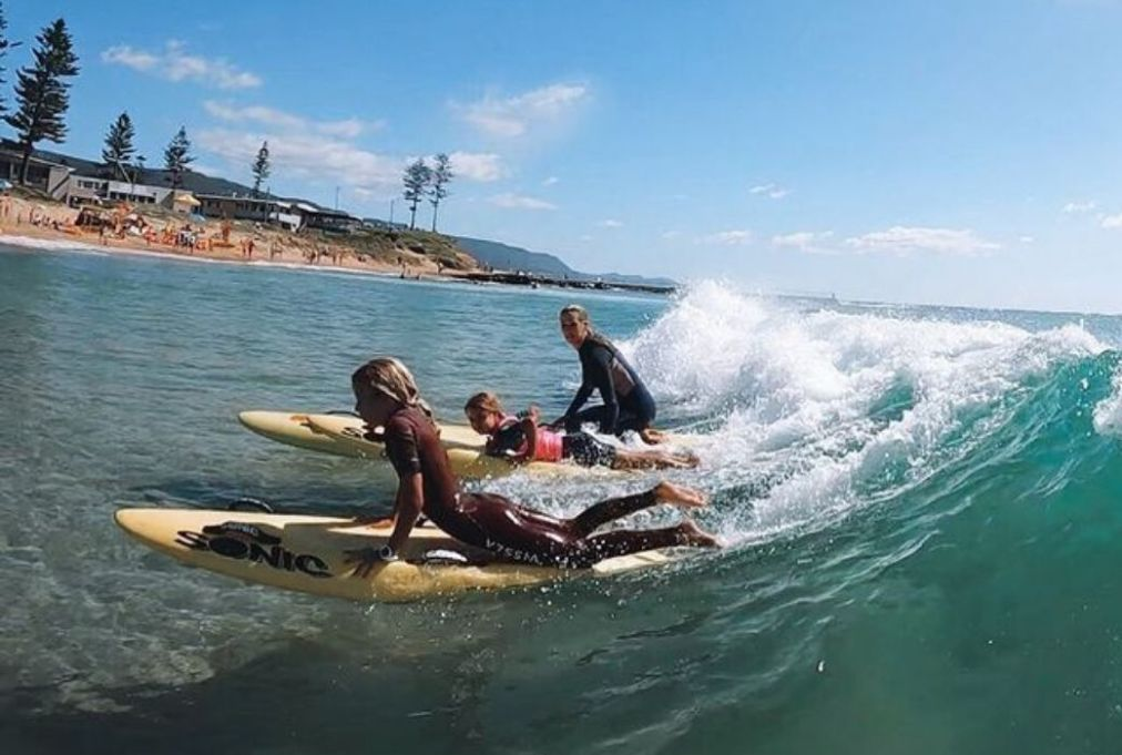 Jade Berg surfing with her family